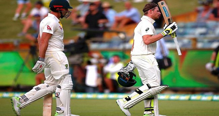 Australia's captain Steve Smith walks in front of team mate Shaun Marsh as they walk off the ground at the end of the second day's play of the third Ashes cricket test match. Photo: Reuters