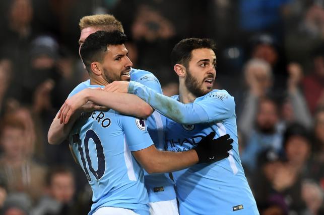 Manchester City's Argentinian striker Sergio Aguero (L) celebrates with teammates scoring the team's