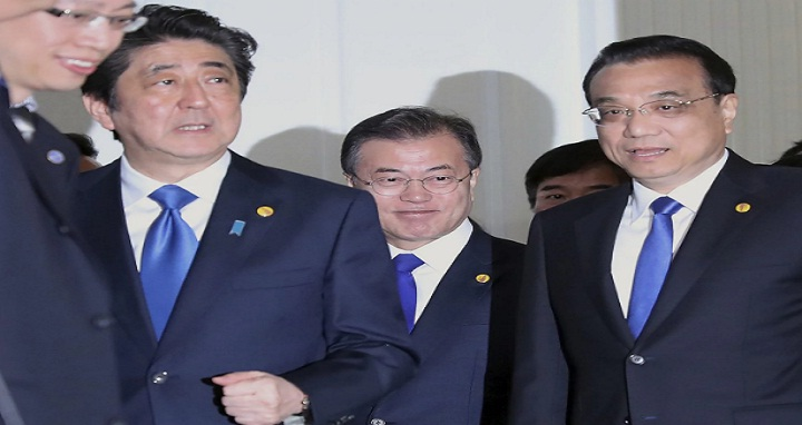Chinese Premier Li Keqiang, right, Japanese Prime Minister Shinzo Abe, left, and South Korean President Moon Jae-in, center, walk together to their summit venue in Tokyo Wednesday, May 9, 2018. The summit is expected to focus on North Korea's nuclear program and on improving the sometimes-frayed ties among the three northeast Asian neighbors. (Eugene Hoshiko, Pool/Associated Press)